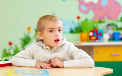 cute kid, boy with special needs in rehabilitation center